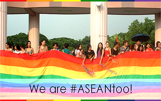Photo of large number of people holding large rainbow flag, with caption 'We are ASEAN Too'